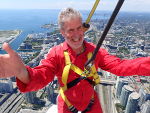 Jeff high above Toronto surviving the CN Tower Edgewalk.